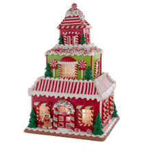 Add a sweet touch to your holiday decoration with this Kurt Adler 16.5-in Gingerbread House with LED Lights! This table piece features a multistory home adorned with sprinkles, peppermint candies, and Christmas themed cookies. When switched on, the train house are illuminated from within.