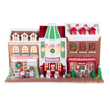 Bring some sweetness to your holiday decoration with this 10-in Gingerbread Santa Village Stores with LED Lights from Kurt Adler! This gingerbread house features a Christmas cottage, toy shoppe, and candy shoppe. Couples are lined up outside each business. This colorful display is the perfect addition to any holiday decoration!