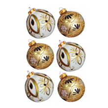 These Kurt Adler gold and white decorated glass ball ornaments are a classic addition to your Christmas tree decoration. This box set includes six gold and white decorated glass ball ornaments.