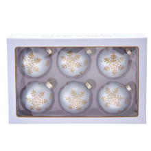 These 80MM Silver with Gold Snowflakes Glass Ball Ornaments, 6-Piece Set from Kurt Adler are a classic addition to your holiday decoration! This six piece set features a white ornament with gold glitter snowflakes in various shapes and sizes. This set is the perfect way to bring the snow into your home without the chill!