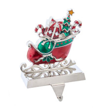 This 7.3-in Metal Sleigh Stocking Hanger from Kurt Adler is the perfect way to hang the stockings by the chimney with care in the hopes that Saint Nicholas soon will be there. This stocking holder features a red sleigh with holly berry accent. The sleigh is filled with traditional Christmas themed objects: presents, a Christmas tree, and candy canes.