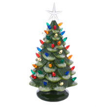 Add a touch of elegance with Kurt Adler's B/O LED ceramic green Christmas tree. This tabletop lighted green tree is decorated with white glitter and sequins and features a bright star treetop.