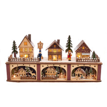 This 8.66-in B/O Village LED House from Kurt Adler will add some holiday cheer and brighten up your home. This piece features a row of quaint houses lit by warm white LED lights. Cutouts underneath depict various winter scenes. Powered by 2 AA batteries, not included.