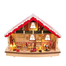 """This 13.38-in B/O Musical Village LED House from Kurt Adler will add some holiday cheer and brighten up your home. This centerpiece offers a look into a festive holiday home filled with furniture and toys. Lit by 10 warm white LED lights and plays the tune of """"Silent Night"""" when powered by 2 AA batteries, not included."""