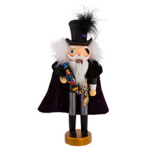 "This Kurt Adler 12"" Hollywood Drosselmeyer Nutcracker is a fun, festive way to add to your holiday decoration or nutcracker collection. Designed by renowned artist Holly Adler, Hollywood Nutcrackers is a whimsical collection of nutcrackers created exclusively for Kurt S. Adler, Inc. and features an assortment of designs including Christmas, fantasy and everyday nutcrackers. Their designs put a unique, vibrant, memorable twist on traditional nutcrackers. This nutcracker features a major character in ""The Nutcracker Suite,"" Drosselmeyer, with his signature tophat, eye patch, and dramatic cape. He is holding his own tiny detailed nutcracker, and is standing on a round golden base."