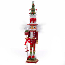 Hollywood Nutcrackers is a whimsical collection of nutcrackers created exclusively for Kurt S. Adler, Inc. and features an assortment of designs that put a unique, vibrant, memorable twist on traditional nutcrackers. This 15-in nutcracker design features shades of red and green accented by gold and white. He is topped with a tall Christmas tree hat for an extra festive touch.