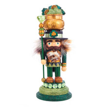 Hollywood Nutcrackers is a whimsical collection of nutcrackers created exclusively for Kurt S. Adler, Inc. and features an assortment of designs that put a unique, vibrant, memorable twist on traditional nutcrackers. This 12-in Irish Nutcracker is dressed in green and gold glitter on an emerald base. In his right hand he is holding a emerald gem topped staff and his hat is his lucky pot o' gold complete with glittered shamrocks and gold pieces.