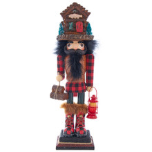 Hollywood Nutcrackers is a whimsical collection of nutcrackers created exclusively for Kurt S. Adler, Inc. and features an assortment of designs that put a unique, vibrant, memorable twist on traditional nutcrackers. This 18-in Hollywood Lodge Nutcracker with Cabin Hat is living his best lodge life. He is wearing a red and black plaid outfit from his shirt to his boots. This nutcracker features a lodge hat and is holding a lantern in his left hand and sack of logs in his right.