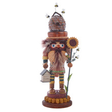 Hollywood Nutcrackers is a whimsical collection of nutcrackers created exclusively for Kurt S. Adler, Inc. and features an assortment of designs that put a unique, vibrant, memorable twist on traditional nutcrackers. This 15-in Hollywood Bee Keeper Nutcracker is standing on a sunflower base while holding a sunflower in his left hand and bee house in his right. His hat is a beehive and his suit has a honeycomb design. Bees are flying all around the nutcracker between the sunflower and beehive. This nutcracker will give you a new friendlier perspectives of bees!