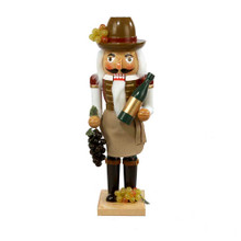 """This Kurt Adler 15"""" Wooden Wine Grower Nutcracker is a fun, festive way to add to the holiday decoration of any wine-lover! This nutcracker features a beautifully detailed gold, brown and green design; his hat has a bunch of green grapes tucked into the brim, there are green grapes at his feet, purple grapes in one hand, and a bottle of wine in the other hand. He is standing on a square wooden base."""