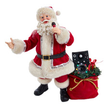 """This 10.5-in B/O Fabriche Musical Karaoke Santa from Kurt Adler is the perfect addition to your holiday decoration! This table piece features Santa with a microphone in hand. Peeking from his sack is a stereo. Record a message for your guest with the record function on this table piece. When switched on, the tune """"We Wish You A Merry Christmas"""" plays and the lights on the stereo go on."""