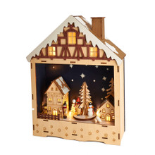 """This B/O Wooden Musical LED House from Kurt Adler is a beautiful and unique addition to any holiday decoration. Its base features a house design complete with windows and a chimney. This table piece features two houses and a Christmas tree. When switched on, the houses light up from within and """"Silent Night"""" plays."""