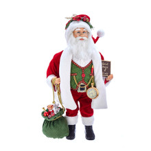 """This 18-in Kringle Klaus Red, Green, and White Santa from Kurt Adler is a fun and festive addition to any holiday decoration. Part of the Kringle Klaus collection, Santa is featured here in his traditional red-and-white suit. In one hand is a book with the names of all the """"Good Boys & Girls"""", and in the other hand is a sack full of presents."""
