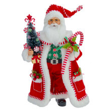 This 17-in Kringle Klaus Candy Santa with Candy Cane and Tree from Kurt Adler is a fun and festive addition to any holiday decoration. Part of the Kringle Klaus collection, Santa is featured wearing a red suit with candy cane trimmings, holding a candy cane and a tree decorated with peppermints.