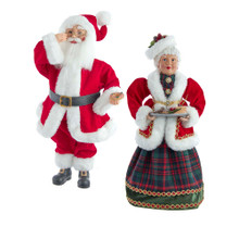 This 16-in Kringle Klaus Santa and Mrs. Claus 2-piece set from Kurt Adler is a fun and festive addition to any holiday decoration. Part of the Kringle Klaus collection, Santa has been kissed and is wearing a traditional red and white Santa suit with matching Santa hat and black boots with gold buckles. Mrs. Claus is wearing a plaid dress with a red and white coat and she is carrying a tray of cookies.