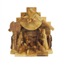 "Celebrate and remember the true meaning of Christmas with this Olive Wood Nativity Music Box from Kurt Adler. It is handmade in Bethlehem, carved from olive wood from the Holy Land. Its wooden finish features simple carved figures making up a beautiful Nativity scene. When the star on top of the crèche is wound up, this piece plays the tune of ""Silent Night."""