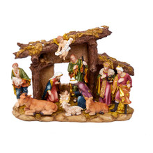"Celebrate and remember the true meaning of Christmas with this Resin Nativity Set with Figures and Stable from Kurt Adler. This set includes a stable topped with an angel holding a sign that reads ""Gloria,"" and 10 resin figures. Figures included are the Baby Jesus, Mary, Joseph, the Three Wise Men, a shepherd, a cow, a lamb, and a donkey."