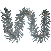 This Kurt Adler 9-ft pre-lit silver ice garland is a beautiful, festive way to add to your holiday decoration. Perfect for large outdoor areas in need of a little extra holiday cheer. Features a classic garland in shimmery silver with 280 tips and adorned with 50 UL lights to make this garland sparkle.