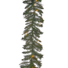 This Kurt Adler 9-ft pre-lit Designer Series classic green garland is a beautiful, festive addition to your holiday decoration. Perfect for a little extra dash of holiday cheer, this classic green garland features bright green needles with 180 tips and is lit with 50 clear UL lights that give a warm glow to any holiday display.