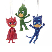 "This PJ Masks Ornament Set of 3 from Kurt Adler is a fun and festive addition to the holiday decoration of any fan of the popular show! This set includes Gekko, Catboy, and Owlette, each in their colorful costumes. Each ornament is approximately 3""-3.5"" tall."