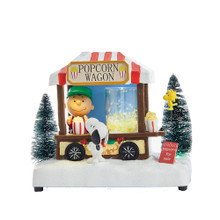 This 7-in B/O Peanuts© LED Musical Table Piece from Kurt Adler is a fun and festive addition to any holiday decoration! Perfect for Peanuts© fans and collectors, this piece features Charlie Brown working the Popcorn Wagon, handing popcorn to Snoopy. Woodstock is in the background watching the scene unfold. When switched on, the wagon lights up and is open for business, the tree is illuminated, and the classic Charlie Brown music plays.