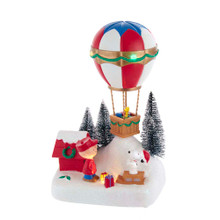 This 9-in B/O Peanuts© Musical Animated Hot Air Balloon Table Piece from Kurt Adler is a fun, festive way to add to your holiday decoration or display. The scene depicts a snowy hill with Snoopy and Charlie Brown admiring their hot air balloon. Woodstock is waiting for the two in the hot air balloon to take off! Tihs table piece plays the Peanuts© theme song and is animated.
