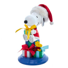 This 8-in Peanuts© Fabriche Snoopy and Woodstock Table Piece from Kurt Adler is a fun, festive way to add to your holiday decoration or display. Snoopy is featured sitting on a bed of presents, holding his gift and wearing a festive hat. Beside him is his friend Woodstock sitting on a present.