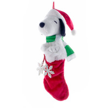 This Kurt Adler 21-in Peanuts Snoopy Plush Head Stocking with Snowflake Dangles is a fun, festive way to add to the holiday decoration of any Peanuts fan! Sticking out of the top of this classic red and white stocking is a large plush Snoopy wearing a Santa hat and a green and white striped scarf. Dangling from him are two large snowflakes.