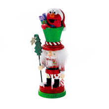 Designed by renowned artist Holly Adler, Hollywood Nutcrackers is a whimsical collection of nutcrackers created exclusively for Kurt S. Adler, Inc. and features an assortment of designs including Christmas, fantasy and everyday nutcrackers. Their designs put a unique, memorable twist on traditional nutcrackers. This 12-in Elmo Hollywood Nutcracker from Kurt Adler is a fun and festive addition to any holiday decor or nutcracker collection. This nutcracker is wearing a red, green, and white outfit finished with glitter and peppermint detailing. Elmo is featured in Its tall hat wearing a Santa hat.