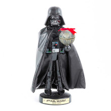 This Star Wars Darth Vader with Death Star nutcracker by Kurt Adler is a fun and festive way for any Star Wars fan to add to their holiday decor or nutcracker collection. Darth Vader is featured here wearing his iconic all black armor and cape, while holding a beautifully detailed Death Star topped with a ribbon.
