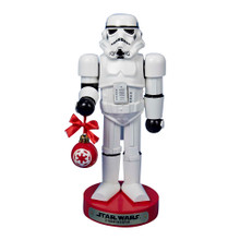 This 9.5-in Stormtrooper with ball ornament Nutcracker by Kurt Adler is a fun and festive way for any Star Wars fan to add to their holiday decoration. A Stormtrooper is featured here wearing his signature white and black armor. He is holding a Christmas ornament with a ribbon for an extra festive touch.
