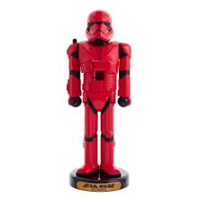 This 10-in Red Sith Trooper Nutcracker from Kurt Adler is a great addition to your nutcracker collection. It features a Red Sith or Sith Purebloods and is a species of red-skinned Humanoids with a higher than average concentration of Sith blood. This is perfect for any Star Wars loving fans!