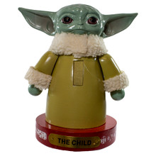 """This 9.5-in The Child Nutcracker from Kurt Adler is a fun addition to any holiday decoration! """"The Child"""" AKA Baby Yoda is standing on a red base decorated with white snowflakes and a gold Colored name plate. This is perfect for all Star Wars loving fans!"""