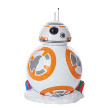 This 9.25-in B/O BB-8 LED Treetop from Kurt Adler is perfect for the holiday decoration or collection of any Star Wars fan. Perfect for fans of The Force Awakens, the adorable BB-8 droid is featured here with a snowy base and Christmas gifts. When switched on, he glows with LED lighting. B/O, this treetop uses 2 button cell batteries (included).