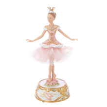 "This 10-in Pink Ballerina Figure with Musical Base from Kurt Adler is a beautiful addition to any holiday decoration. This ballerina is wearing a pink tutu with intricate embellishments, a crown, and stands on top of a gold and white base. This musical piece plays ""The Nutcracker Ballet"" for a festive touch."