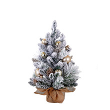Bring the beauty of nature to any holiday decoration with this 24-in Flocked Tree with Ornaments, Pinecones, and Burlap from Kurt Adler! This tree comes with silver and gold ornaments and pine cones to take the worry out of decorating. The tree sits on a burlap base for a nature inspired touch.