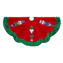 Add the perfect finishing touch to your Christmas tree with this 48-in velvet nutcracker tree skirt from Kurt Adler. Its red design features a thick green scalloped edge, and colorful nutcracker adornments throughout.