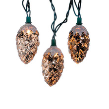 "Add to your lighting and decoration with this UL 10-Light Pinecone Light Set from Kurt Adler. Perfect for adding a nature-inspired touch to your decor, each light cover in this set features a beautiful textured pinecone design. Each set has a 30"" green lead wire, 12"" spacing, and 12V 0.08A clear yellow incandescent bulbs. For indoor use only."