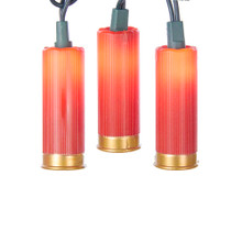 """This Kurt Adler UL 10-Light Red Shotgun Shell Light Set is a unique, festive way to add to the lighting of your holiday or theme party decoration! Each light in this novelty indoor-outdoor light set features a plastic red shotgun shell. All lights shine with 12V 0.08A clear bulbs. This set has a 30"""" lead wire, 12"""" spacing, green wire, 4 spare bulbs and 1 spare fuse."""