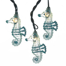 """This Kurt Adler UL 10-Light Glittered Seahorse Light Set is a fun and unique addition to any holiday or theme party decoration. Each of the ten lights in this novelty light set has an adorable clear seahorse lined in blue glitter. Each set has a 30"""" x 12"""" green lead wire and is for both indoor and outdoor use."""