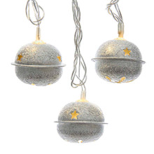 This 10-light silver metal bell with warm white led light set from Kurt Adler is a rustic addition to your holiday lighting decoration. Each silver bell is lit by warm white LED lights with star cut-outs design.
