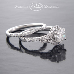 Style PDJ705 - 1.48CT. Total Diamond weight Diamond Engagement ring with round Halo and Matching Band in fine 18K White Gold.