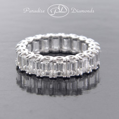 Style PDSPO175 - 5.01ct Matching Fine Emerald Cut Diamond Eternity Band Set in Fine 18K White Gold.