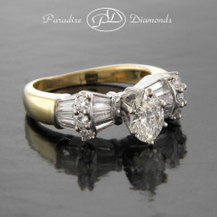 Style PDX559 1.50CTTW Oval Center Diamond With Round And Baguette Accent Diamonds 14K Yellow And White Gold