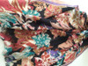 Close Up of Richly Patterned Floral Scarf on Black