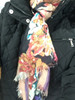 Close Up worn of Richly Patterned Floral Scarf on Black