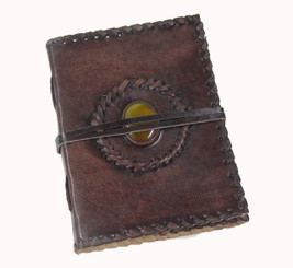 stitched leather journal with yellow stone centre piece embedding into cover