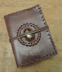 leather journal with stitching and stone centre
