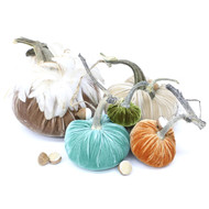 """The Cozy Pumpkin Large set with Feathers includes a 8"""" Mocha with feather collar, 6"""" Bone, 5"""" Lagoon, 4"""" Spice and 3"""" Cactus velvet pumpkin. We've added a sprinkle of 4 ivory and 2 bone acorns."""