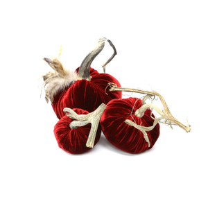 """The Reds Pumpkin Trio with Feathers includes a 6"""" Red velvet pumpkin with feather plume, 5"""" Cherry velvet pumpkin and 4"""" Cherry velvet pumpkin."""